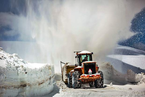 A Colorado Department of Transportation snowblower removes snow from Independence Pass Wednesday.  The pass typically opens the Thursday before Memorial Day.