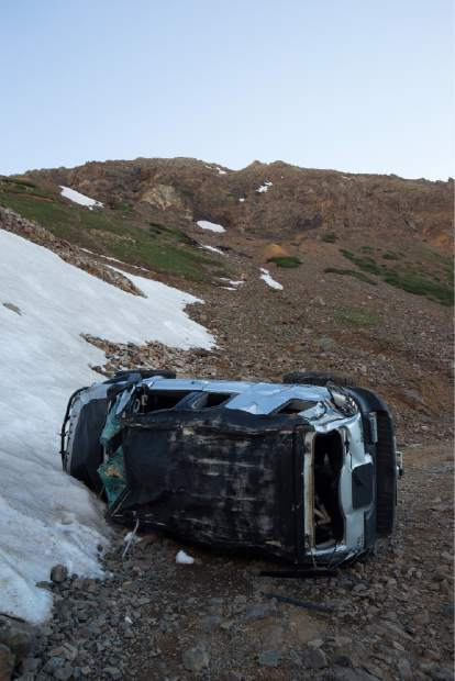 This Toyota FJ Cruiser, driven by Denver resident James Scully, came to rest on its side after Scully rolled it at least 6 times down a steep mountainside near Montezuma Basin, toward the trailhead to Castle Peak and Conundrum Peak. Read about the harrowing incident on page A3.