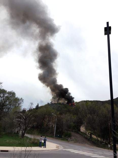 A plume of smoke is visible from the house destroyed by fire Monday afternoon in south Glenwood Springs.
