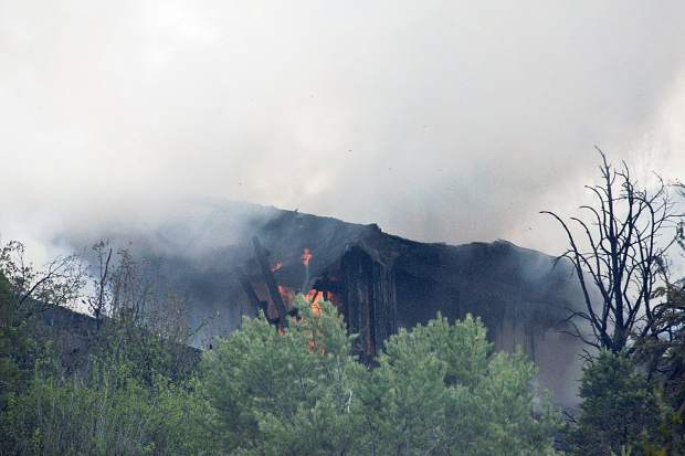 The shell of a burned house is left toward the end of Monday's battle against the fire in south Glenwood Springs.