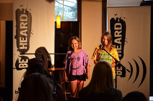 Katie and Daisy, both 9, of Carbondale, perform the song