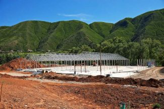 The frames for several Silverpeak Apothecary greenhouses off of Highway 82 near Basalt take form on Tuesday. Silverpeak owner Jordan Lewis hopes the greenhouses will be ready for inspection and licensing by October 1.