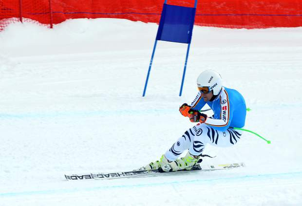 A German national team member gets low on the downhill course at Copper Mountain during early-season training on Nov. 19.