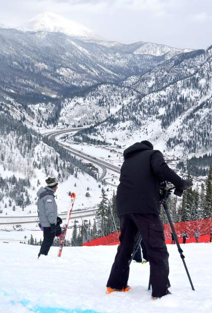 Videographers and coaches with the U.S. Ski Team stake out a spot on the early-season downhill course at Copper Mountain on Nov. 19. The training gives coaches and athletes time to film and review technique before the World Cup season kicks into high gear.