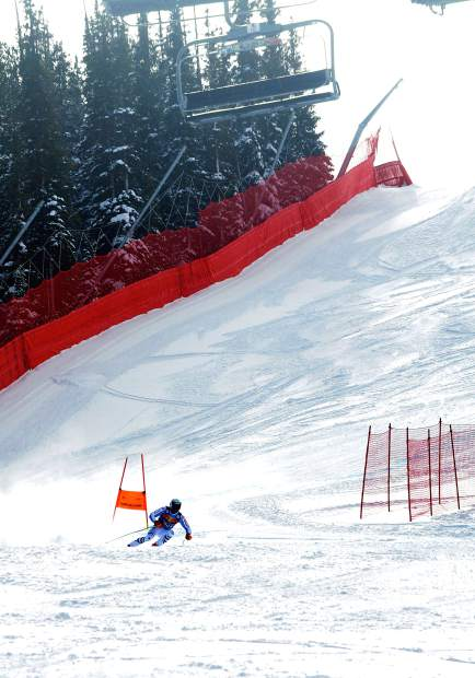 An unidentified national team skier cruises through the final few turns of the downhill training course at Copper Mountain on Nov. 19.