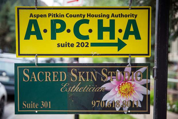 A sign points to the Aspen-Pitkin County Housing Authority office in Aspen.