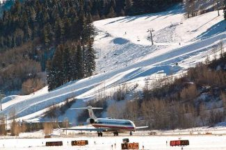 An American Airlines flight prepares to take off on the newly lengthened runway at the Aspen-Pitkin County Airport in December 2011, shortly after the $15.4 million extension project was finished. The impact of the longer runway has exceeded expectations, according to Jim Elwood, airport director.