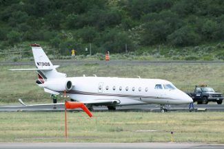A private jet rests partially off the runway at the Aspen-Pitkin County Airport Wednesday afternoon.