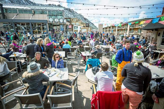 A crowd fills the Ajax Tavern patio on a sunny afternoon for Aspen closing day.