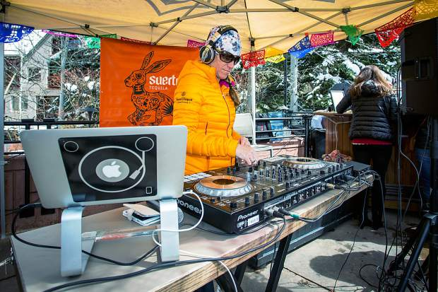 DJ Mayfly plays music at Ajax Tavern on Aspen Mountain closing day.