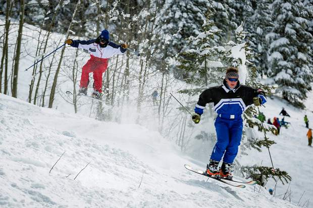 Skiers fly down Copper Bowl on Aspen Mountain closing day Sunday.