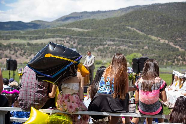 Family members watch as their students celebrate graduation at Basalt High School Saturday.