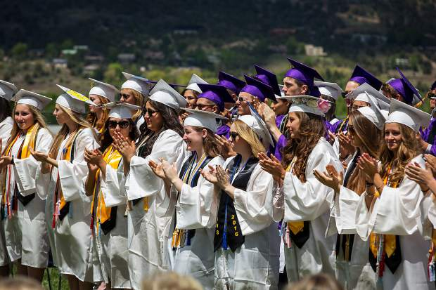 Basalt High School graduates applaud a speaker at the ceremony Saturday.