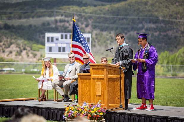 Peter Mueller and Roger Ramos give a welcome at the Basalt High School graduation ceremony Saturday.