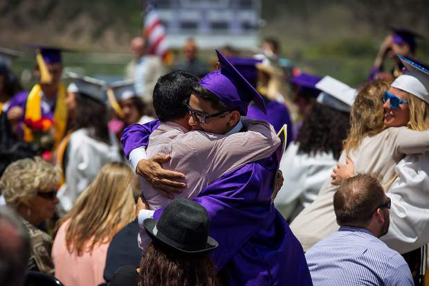 Basalt High School graduates hug family memembers at the graduation ceremony Saturday.