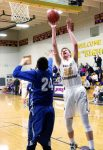 Basalt's Mike Glen, shown here in an earlier game, scores 24 for the Longhorns in the regional game against Pagosa Springs.