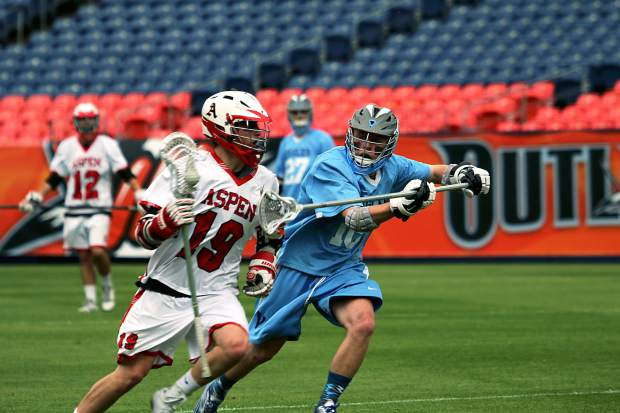 Aspen High School senior John Heaphey (19) pushes the attack against Valor Christian on Friday night during the Class 4A state lacrosse championship game at Sports Authority Field at Mile High in Denver. Heaphey scored five goals as the Skiers won 17-12 for the school's first state lacrosse title.