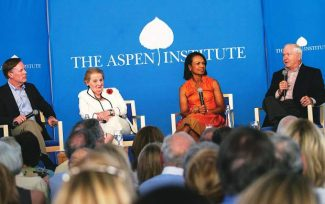 Nicholas Burns, left, moderates a discussion with Former Secretaries of State Madeleine Albright and Condoleezza Rice and former Secretary of Defense Robert Gates.
