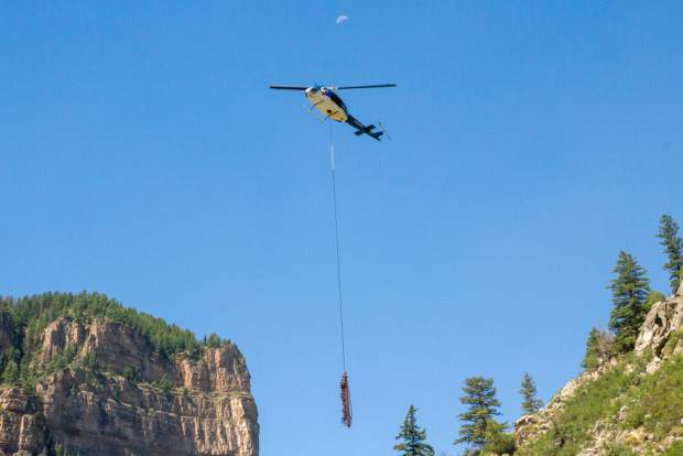 The Huey helicopter was used to lift 13 steel posts, weighing 1,800 to 2,800 pounds each.