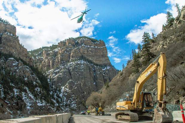 I-70 through Glenwood Canyon was closed from 9 a.m. to 4 p.m. Tuesday for helicopter operations. The helicopter helped install rockfall netting high on the slope where the original rockfall occurred last month. Construction crews took advantage of the road closures to continue repairs on both the east and westbound decks where large boulders left numerous holes.