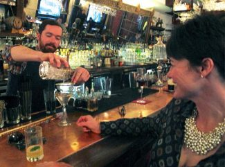 """Conor Kneeshaw, a bartender at Justice Snow's, serves a martini to Melissa Long, of Aspen. State authorities cited Justice Snow's on Dec. 13 for allegedly serving alcohol to a minor.  """"I know we run a great operation here and care about our community,"""" said owner Michele Kiley. """"We make it a goal to be family-friendly and I sought to embrace the culture of recovery. We offer a whole drink menu made up of non-alcoholic drinks."""""""
