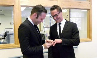 Ricardo Massolini, left, and James Ontko, both of Snowmass Village, present each other with rings after becoming the first couple in Pitkin County to seek a civil union. The pair appeared in the county Clerk and Recorder's Office shortly after it opened Wednesday, the first day the Colorado Civil Union Act went into effect.