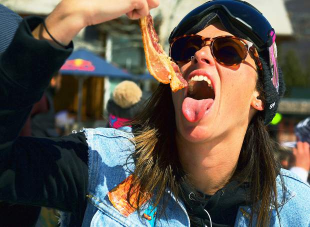 A bacon lover enjoys a savory sample at Buttermilk Mountain's closing day, otherwise known as Bacon Appreciation Day, this year.
