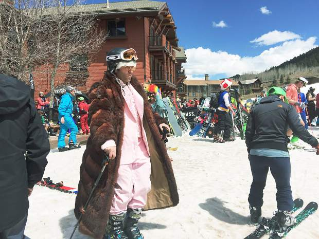 Costumes and silly clothing run the gamut on closing day at Aspen Highlands, like this pink suit and fur coat.