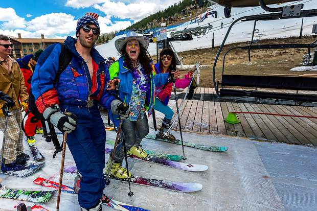 80s fashion makes a comback on closing day at Aspen Highlands. One-piece ski suits and neon jackets are among the many colorful costumes see around the mountain.