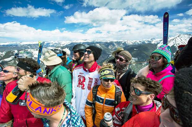 Skiers and boarders send off the season at the top of Highland Bowl.