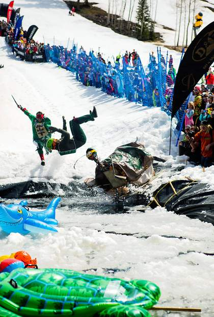 Participants get air before crashing down on the Schneetag pond at Highlands.