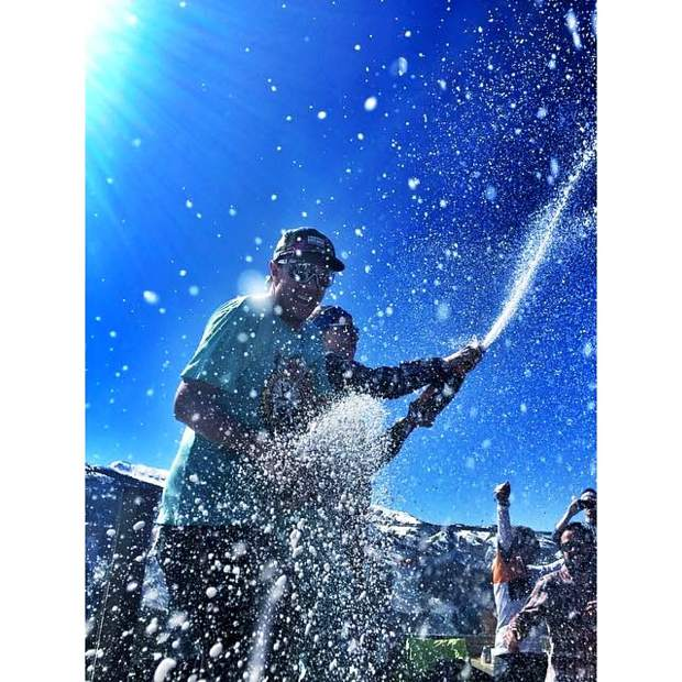 Aspen native Dustin Hite sprays champagne on the deck of Cloud 9 at Aspen Highlands closing day last year.