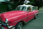 Janie Bennett of Basalt hangs in one of the classic cars of Cuba during a trip in March.
