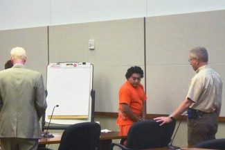 Williams Anderson Amaya, in orange, is directed to the defendant's table in an Eagle County District Courtroom during a hearing earlier in July.