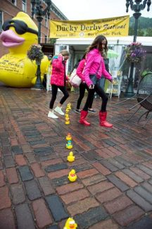 A line of rubber ducks leads to the Ducky Derby booth on the Cooper Avenue mall on Wednesday. Despite the rain throughout the afternoon, rubber ducks were sold by the Aspen Rotary Club for its annual fundraiser. The ducks will race down the Roaring Fork River on Saturday as part of a full day of events. A winning duck can pay up to $1 million, and so far $209,836.17 has been raised for this year's event with the ultimate goal of $300,000.