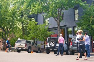 Aspen Police officers cordoned off an area of the sidewalk along South Hunter Street on Tuesday afternoon to keep pedestrians from getting too close to a black bear sleeping in a tree.