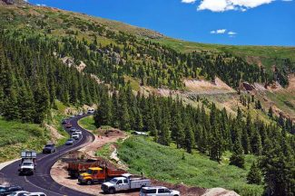 A Colorado Department of Transportation pilot vehicle escorts traffic down Independence Pass on Tuesday, while road paving operations take place. Ten- to 15-minute delays can be expected through Thursday afternoon, near mile marker 60 just below the summit of the pass.