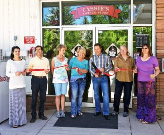 Mike Solondz, owner of Cassie's Corner Store, cut the ribbonfor the store's opening Thursday with the store's general manager, Jody Dible, to his left, on Thursday. Basalt Mayor Jacque Whitsitt, third from left, and members of the Basalt Chamber of Commerce attended. The store and Phillips 55 gas station on Midland Avenue will hold a grand opening June 13-15.