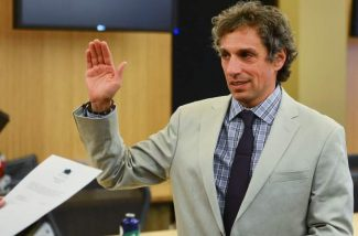 Steve Skadron was sworn in as as mayor of Aspen on Monday night by attorney Ted Gardnenswartz.