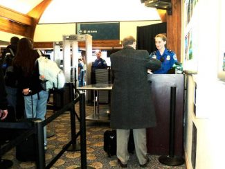 "Kat Chorman, a transportation security officer, helps a customer in the new Transportation Security Administration check-in line at the Aspen Airport. TSA Pre is an expedited screening program that allows pre-approved travelers to leave on their shoes, light outerwear and belt, keep their laptop in its case and their compliant liquids/gels bag in a carry-on in select screening lanes. The first TSA Pre line opened at Aspen Airport on Friday. It's a two-part process for those who wish to apply for the program. First access the aspenairport.com website, find the link to ""pre-check"" and fill in the information required. The second part of the application must be done in-person. People who live near Aspen can chose an application date at Aspen Airport between either March 11-13 or March 18-20. The next closest in-person application sites are Grand Junction and Denver."