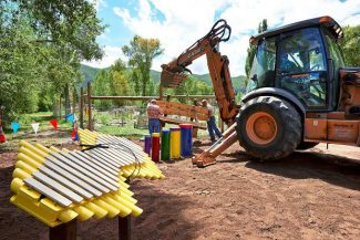Town of Basalt workers install a bench at the new Harmony Park in on Tuesday. The park features six musical instruments that the public can play. The park is estimated to be completed at the end of next week.