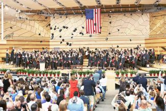 Graduates of the Aspen High School class of 2014 toss their caps in celebration after receiving their diplomas Saturday afternoon at the Benedict Music Tent in Aspen.