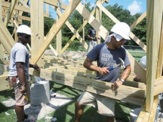 """Student Erick Bowen, left, and instructor Matt Miller work on a community building project in """"If You Build It."""" Miller will attend Sunday's film screening at the Wheeler."""