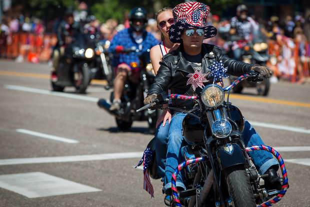 Bikers cruise down Main Street for the 4th of July Monday.