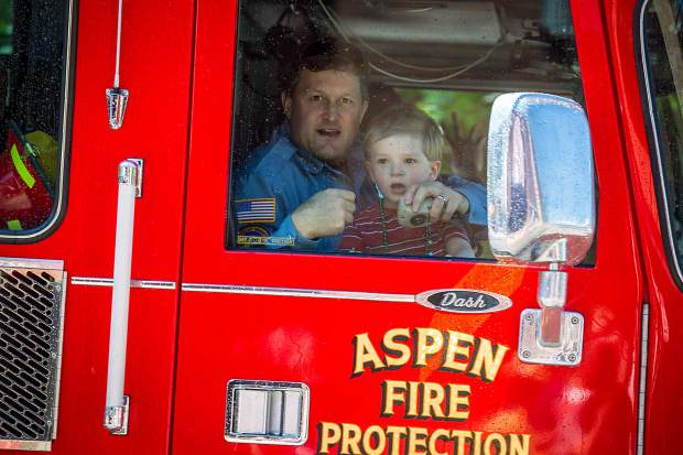 An Aspen fire truck passes by for the 4th of July parade.