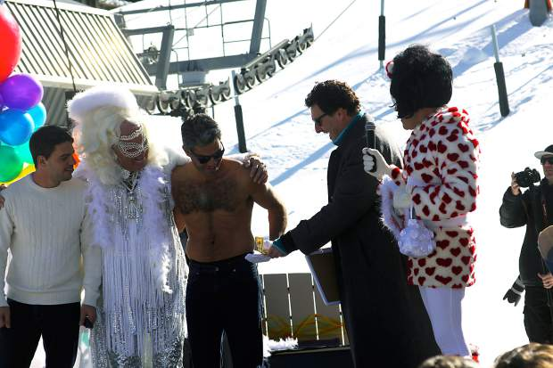 Pitkin County Sheriff Joe DiSalvo, second from right, jokes around with participants in Aspen Gay Ski Week's Downhill Costume Contest Friday by handing them money.