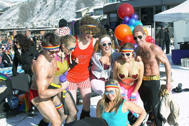 The team from the Aspen Club & Spa poses for photographs after the Downhill Costume Contest at Aspen Gay Ski Week.