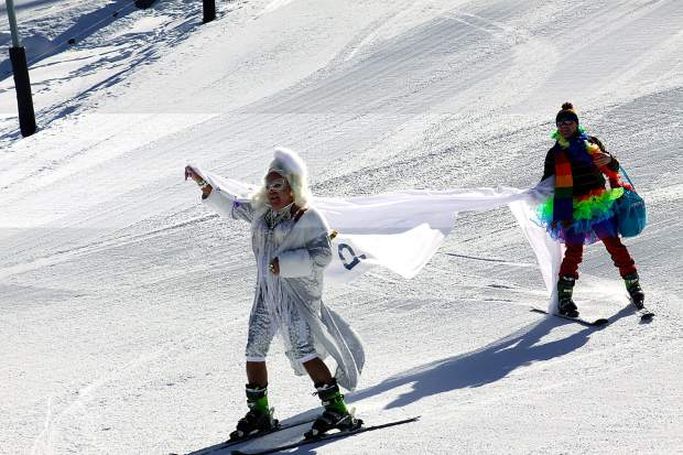 Participants in the Aspen Gay Ski Week Downhill Costume Contest ski down the Little Nell run Friday afternoon.