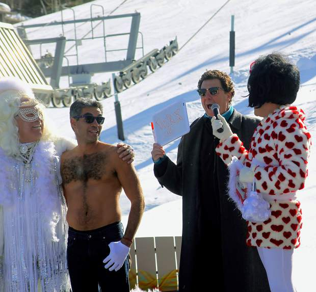 Pitkin County Sheriff Joe DiSalvo, second from right, awards a participant 10 points out of a possible 10 during Aspen Gay Ski Week's Downhill Costume contest Friday.