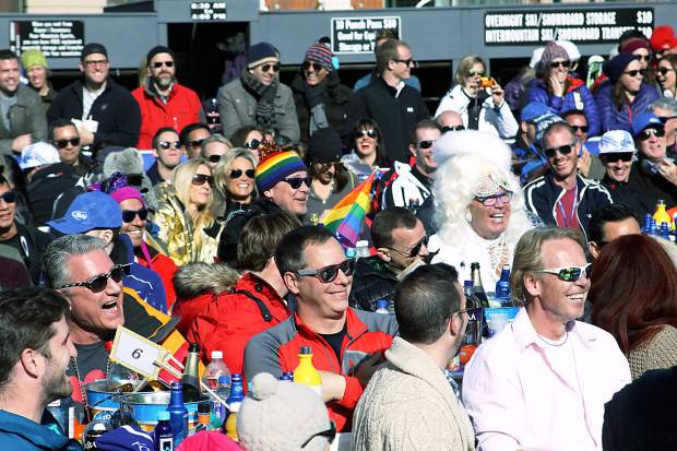 Spectators at Aspen Gay Ski Week's Downhill Costume Contest laugh as they watch the show from the base area next to the Silver Queen Gondola.